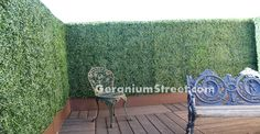 Privacy Wall Design with Faux Boxwood Hedge
