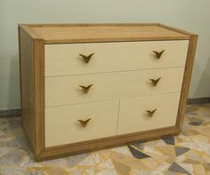 Chest of drawers in ash solid wood, finished in walnut and ivory color.