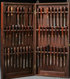 Fifty Holtzapffel & Co. Turning Tools, London, with turned wood handles, assortment of steel profile edges marked Holtzapffel & Co., all in a hinged mahogany paneled cabinet, ht. 31 in. Estimate $2,000-4,000