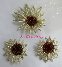 Sarah Coventry  https://www.etsy.com/listing/238440722/starburst-pin-brooch-earrings-gold-tone