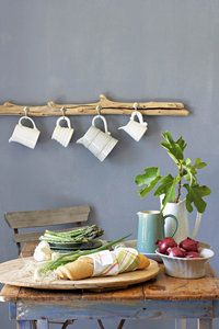 Kitchen. awesome piece of wood with hooks underneath the chalkboard for mugs to hang.