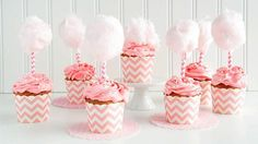 Tiny little twists of cotton candy top bright pink cupcakes, which are spiked with cotton candy-flavored vodka.