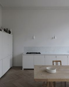 Est living - white and marble kitchen with period features
