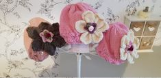 Baby and toddlers beautiful hand knitted flower hats and Aran Jumper, Knitted Flowers, Baby Hands, Flower Hats, Jumpers, Beautiful Hands, Hand Knitting, Toddlers, Crochet Hats