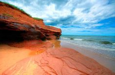 THUNDER COVE Where: Prince Edward Island, Canada  Prince Edward Island near Nova Scotia is full of picturesque beaches, meadows, and farm colonies. Fishermen haul in mussels, oysters, and lobsters from P. E. I.'s shores. What's striking is about half of the beaches have red sand due to high iron oxide content. Thunder Cove is especially surreal and beautiful, with rust-colored sand and dunes.