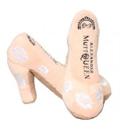 Elegant and regal, this Princess K8 Wedding Shoe Dog Toy is the perfect gift for your stylish pooch.  This unique dog toy looks just like the designer shoes worn by a certain royal bride.  It features an embroidered designer logo and embroidered white roses along the outside of the shoe.  It looks gorgeous and is the perfect gift for your furry fashionista.