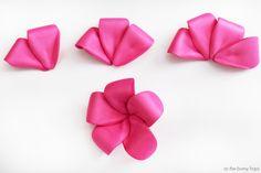 Create cute and fun DIY pink plumeria hair flowers inspired by Disney's Moana!