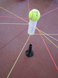 12 neon colored strings attached to a PVC tube. Takes the Bull Ring activity to a whole new level.The challenge is to carry a small ball using the bull ring and