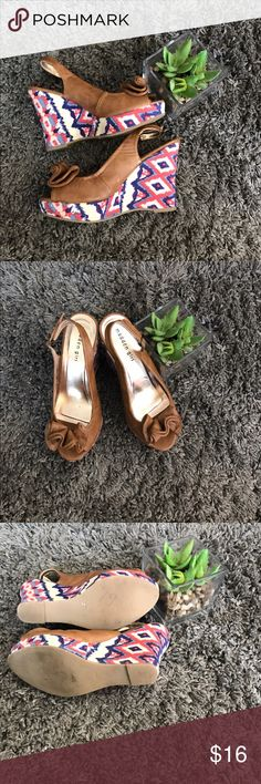 Beautiful tan wedges with colorful decor on heel-8 Beautiful tan wedges with colorful decor on heel and flower on top- size 8- in great used condition maden girl Shoes Wedges