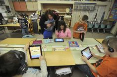 Faculty from the Teachers College at Emporia State University work with elementary students from Madison, Kan., with the teaching with iPads program.