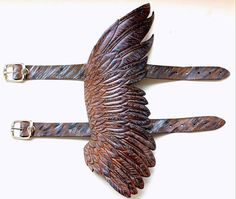 Hand tooled leather winged cuff by Gemsplusleather