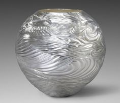 Gallery. Miriam Hanid - Artist silversmith. Silversmithing techniques of chasing, repoussé and hand engraving - The fluidity and movement of flowing water inspires my work.