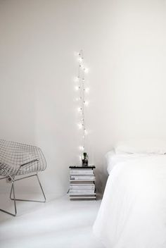 7 Home Hacks That Will Make Your Friends Jealous #refinery29  http://www.refinery29.com/easy-home-decor-diy-materials#slide-2  String LightsDraped over a single nail, a string of white lights goes from cute to contemporary — and, as Elena Gardin shows us here, provides a fresh alternative to a bedside lamp....