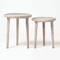 Interlocking round tripod tables in dark, grey and natural shades handcrafted from solid wood, this nest of 2 round side tables can also be used as small bedside tables. Nest of Tables Set of 2 round nesting tables with tripod style wooden legs measurin Large Table, Small Tables, Round Side Table, Low Shelves, Nesting Tables, Acacia Wood, Wood Colors, Furniture Collection, Contemporary Style