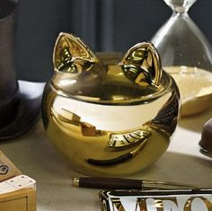 http://www.houzz.com/photos/16551623/The-Emily-Meritt-Gold-Cat-Canister-contemporary-kitchen-canisters-and-jars