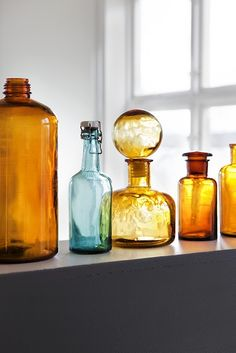 ruemag: Vintage glass - an easy way to spruce up a windowsill! The amber and aqua hues pair beautifully.