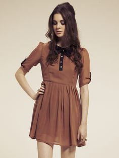 Also in love with this tan bow tie dress by Dahlia. not sure how this color will coordinate with my skin