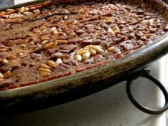 Castagnaccio, a chestnut cake, typical of Tuscan Italian Cuisine.  http://www.crossingitaly.net/travel/1170/castagnaccio-a-chestnut-cake-typical-of-tuscan-italian-cuisine/