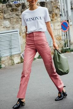 Loving this pink studded pant paired with a white tee and accessorized with oversized statement earrings! Chic!