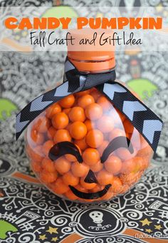 Candy Pumpkins Fall Craft and Gift Idea - so easy and super cute! Made from recycled water bottles shaped like balls.