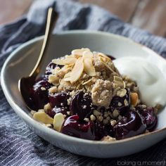 Too hot to bother with the oven?  Try this easy, No-bake Cherry Crumble!  Sweet, plump cherries are sprinkled with buttery streusel crumb topping, toasted almonds, and a dollop of vanilla Greek yog...