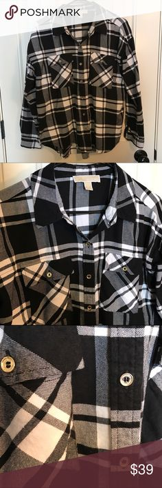 Michael Kors Flannel Plaid button down This Michael Kors Flannel Plaid button down is classic but casual. In other words it's perfect! Has roll tab sleeves. 60% cotton 40% rayon. In perfect condition! Size Large. MICHAEL Michael Kors Tops Button Down Shirts