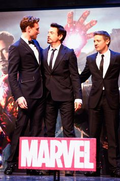 "Tom Hiddleston, Robert Downey Jr. and Jeremy Renner. Look at RDJ's face. Hes like ""Fuck, stretch high, get on your tip toes, almost there. damn why is he so tall."""
