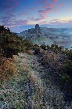 A rather stunning and fantastical view of Corfe Castle in the winter sunlight. The Castle is a fortification built by His Ancientness William the Conqueror during the eleventh century; and stands above the village with the same name in the county of Dorset, England.        For visitor information, what's on, etc look no farther than here (photo by Anthony Spencer on johnstoysoldiers.blogspot.com)  Source: enchantedengland