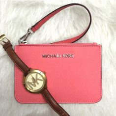 """Michael Kors wristlet NWT Michael Kors wristlet. Pink leather with silver hardware, measures 6""""x4"""". Inside there are two slots for cards. Great closet staple to add the perfect pop of color for spring! *watch is not for sale, watch is not included* comes with care pamphlet. Michael Kors Bags Clutches & Wristlets"""