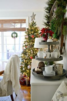The Christmas tree in our rustic and simple cozy Christmas cottage decorated in red with touches of gold. http://www.chafieldcourt.com