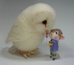 I would love to have something by this woman.  She's a real needle-felting artist.  This links to classes for sale.
