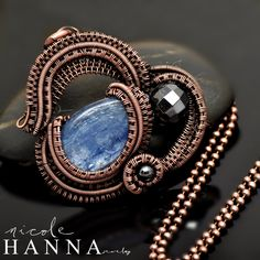 A beautiful kyanite stone is the focal to this wire wrap pendant. Faceted hematite accents the look, which is comprised of many yards of copper wire, which has been hand coiled and woven and layered in curving lines to mimic the soft billowing outline of clouds. This pendant measures 4cm in lengt...