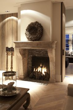 Mantle and fireplace - like the color of the wood More