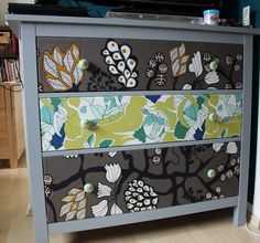 Not sure I like this particular one, but I like the idea of covering the drawers with fabric // IKEA Hackers