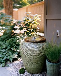 Sonorous Ceramic Water Feature  Greet guests with the tranquil sound of falling water in a pump-fitted urn with a motor that moves the water underground.  How to Make the Sonorous Ceramic Water Feature