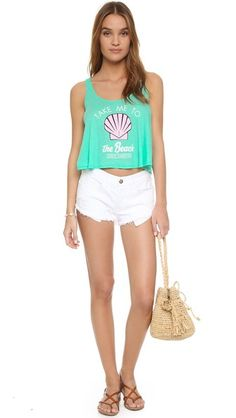 A seashell graphic and lettering accent the front of this slouchy, cropped Wildfox tank. Semi-sheer.
