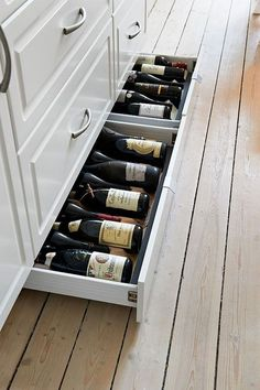 Kitchen Design Idea - Include Toe Kick Drawers In Your Cabinetry For Extra Storage | If you don't have the space or enough wine to justify a large wine rack, a toe kick drawer might be all you need. It keeps the wine out of the way but easily accessible, and makes great use of space that would normally just be wasted.