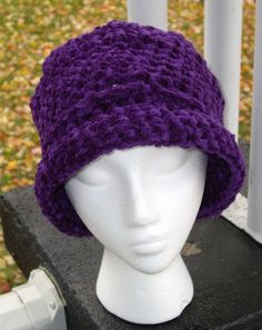 "Reversible Shape Hat - Cloche or Brimmed - Vibrant Purple Chenille. A limited-edition reversible crocheted hat. Designed and handcrafted by me, made only of the finest fibers. You get two hats in one! When worn one way, it is a flat-topped, brimmed hat. Flip it inside out, and it is a cloche. Very cozy and stylish. It truly looks good on anybody, even those who are not ""hat people"". It is made of high quality, plush chenille yarn (acrylic/rayon blend). The color is a vibrant purple. The..."