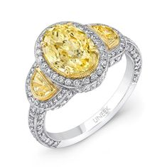 Uneek Natureal Fancy Yellow Halo Oval Cut Diamond Engagement Ring LVS351 - Fancy yellow halo oval diamond engagement ring set on platinum and 18k yellow gold setting.  This diamond engagement ring is set with 180 round diamonds with a total weight of 0.72 carats, along with 2 half moon fancy yellow diamonds at .33 carat, and a center oval shaped GIA certified fancy yellow diamond 1.94 carats.