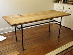 3/4 View Color, Salvaged Butcher Block Table http://www.marybicycles.com/diy-scavenged-butcher-block-tabletop-on-cast-iron-pipe-base/