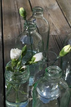 flowers in simple bottles