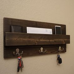 Handmade rustic entryway coat rack mail organizer. Perfect for any home entryway, apartment, or condo. Made of solid wood. It has been lightly sanded down, then stained and sealed with a beautiful satin ebony finish. This piece does not include the accessory items as shown in the pictures. The color of the stained wood captured in the photos might vary slightly. Dimensions: 23 in wide x 11 in tall x 4 in deep (pocket slot 1.5 in deep) Keyhole hangers are installed on the back with heavy ...