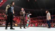"SmackDown LIVE's Roman Reigns, WWE Champion Kofi Kingston and Daniel Bryan emerge on Raw, inspiring Mr. McMahon to announce his ""Wild Card Rule"" for both brands. Daniel Bryan, Kingston, Reign Show, New Wwe Champion, Fantasy Football Players, Roman Reigns Wrestling, Mcmahon Family, Wwe Money, Wwe Raw And Smackdown"