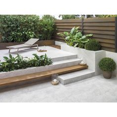 GRL Added Like the planter, and floating stair/seat in wood. Is there a material other than wood that can be used, but looks like wood? maybe use reclaimed wood from garage (red wood) spanischer Mirage Deco White Outdoor Tiles, Outdoor Rooms, Outdoor Living, Outdoor Furniture Sets, Outdoor Decor, Outdoor Cafe, Café Exterior, Exterior Tiles, Exterior Stairs