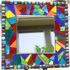 Image from http://www.tinypiecesmakeart.com/wp-content/uploads/2012/04/Mosaic-Mirror.jpg.