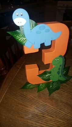 Dinosaur birthday centerpiece instead of 3 do a 2 Dinosaur Birthday Party, 4th Birthday Parties, Birthday Ideas, Dinasour Party, Birthday Centerpieces, Third Birthday, Party Gifts, Party Ideas, Baby