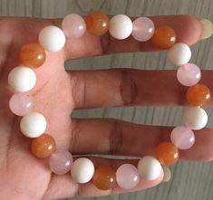 #stonebracelet  #bracelet #healingcrystals #fengshui  #charmbracelet #healingstone Healing Stones, Crystal Healing, Stone Bracelet, Carnelian, Rose Quartz, Pearl Necklace, Shells, Cancer, Pearls