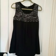 Black tank with ruffles Black tank top, fabric tag missing, feels like a cotton/poly blend, machine washable. The top has a front black and white ruffle front detail, looks super cute with capris Tops Tank Tops