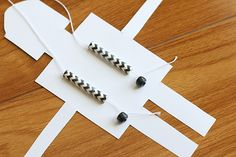 Gliding robot - 1st grade Free printable thread the string through the robot and tie pony beads on each end