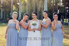 Chiquita's gorgeous bridesmaids wearing our Making History Dress in Grey.